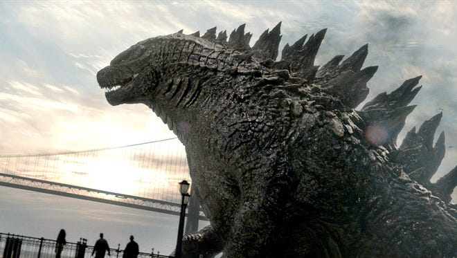 """The monster rises in a scene from """"Godzilla."""""""