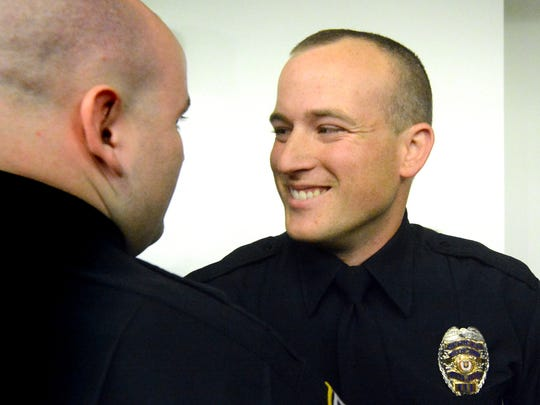 York City Police's 2014 Officer of the Year, Matthew Irvin, is congratulated by fellow Officer Mike Meeker during the departmental awards ceremony at York City Hall in April 2015. (Bill Kalina photo)
