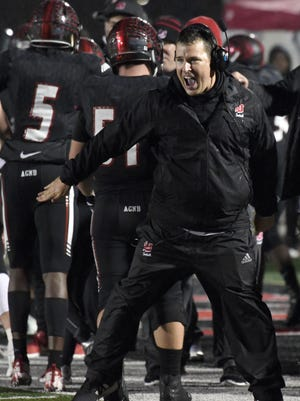 Lafayette Jefferson's head coach Pat Shanley celebrates a touchdown against Noblesville in the Bronchos 35-24 sectional win on Friday October 26, 2018.