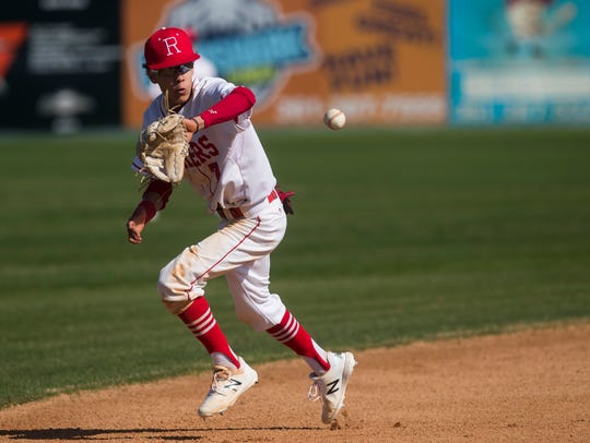 Robstown's Jessie Gonzalez fields a ground ball against