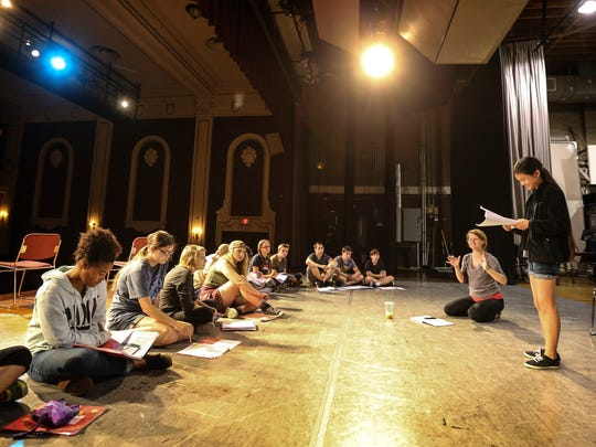 Mary Charles Miller, right, gets instruction from guest artist Maggie Rader at the Clifton Center.  The performance was part of Kentucky Shakespeare camp.June 30, 2016