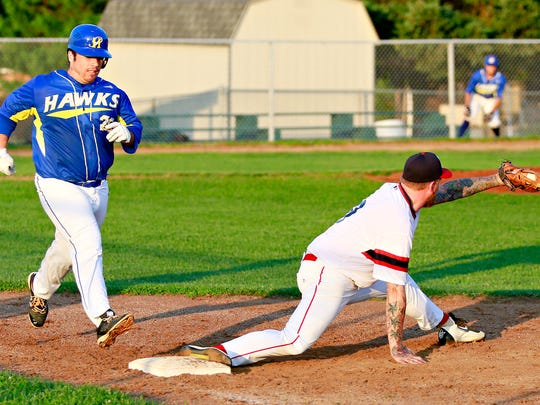 Dillsburg's Gregory Harris, right, catches the ball at first on a double play to out Pleasureville's Colin Parks at first on a double play during York Central League baseball action in Springettsbury Township, Wednesday, Aug. 9, 2017. Pleasureville would win the game. Dawn J. Sagert photo