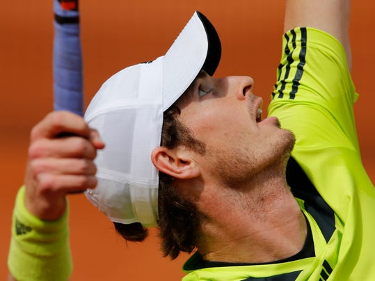 Britain's Andy Murray serves the ball to Australia's Marinko Matosevic during their second round match of  the French Open tennis tournament at the Roland Garros stadium, in Paris, France, Thursday, May 29, 2014. (AP Photo/Michel Spingler)