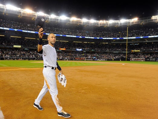Derek Jeter walks the field to thank the fans.