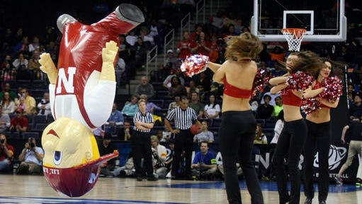 FILE - In this March 31, 2013, file photo, The Nebraska Lil' Red mascot performs during a regional semi-final game at the women's NCAA college basketball tournament in Norfolk, Va. Lil Red is among the 10 pro and seven collegiate mascots have been inducted into the Mascot Hall of Fame will be built in Whiting, Ind. (AP Photo/Jason Hirschfeld, File)