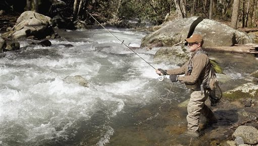 Dana Soucy, of Frankfort, Ky., fishes on Lynn Camp Prong in Great Smoky Mountains National Park March 7 in Gatlinburg. Gatlinburg and three other cities are calling on Congress to fund infrastructure repairs throughout the park.