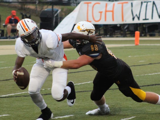 Oak Grove's Jack Harris sacks Wayne County quarterback