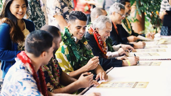 Marcus Mariota signs autographs during the grand opening of the Polynesian Football Hall of Fame on Jan 24 in Oahu, Hawaii. Mariota, presented with the inaugural Polynesian College Football Player of the Year award during the festivities, donated an autographed Oregon Ducks jersey that is on display at the entrance to the hall of fame.