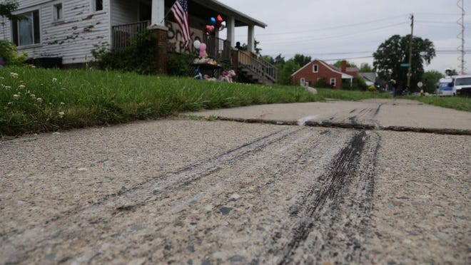 Tire marks seen on the sidewalk on June 25, 2015, the day after a fatal crash on Detroit's east side.