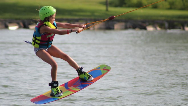 Ashlyn Overland, 8, of Port Jervis, Orange County, wakeboards each weekend at the newly-opened Roseland Wake Park in Canandaigua.