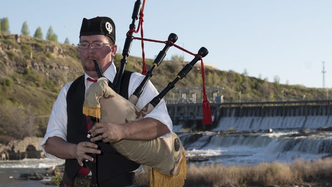 Tim Stoddard plays his bagpipes in front of the Missouri River. Several local bagpipers will be on hand Saturday, Aug. 27, for Kilt o'the Falls.