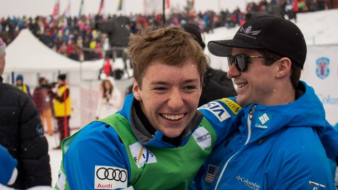 Chris Lillis, left, of Pittsford celebrates his World Cup aerials victory in Minsk, Belarus.