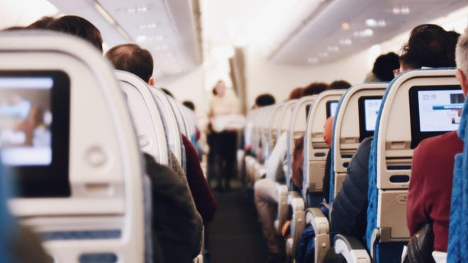 The interior of a passenger airplane. Image by StockSnap from Pixabay