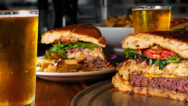 Meet the Fat Freddy burger at The Butcher Shop restaurant and bar in downtown West Palm. Shown in segments in this photo, the burger is a highly shareable 5-pound patty (a blend of chuck, brisket and short rib) with toppings and special sauce, served on a massive, locally made brioche bun.