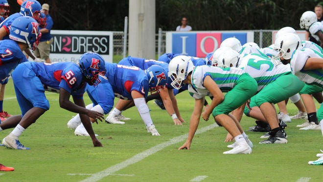 In a game last season, King's Academy and Somerset Canyons players line up before a play. King's Academy could begin practice Monday while Somerset is looking to the School District of Palm Beach County for guidance.