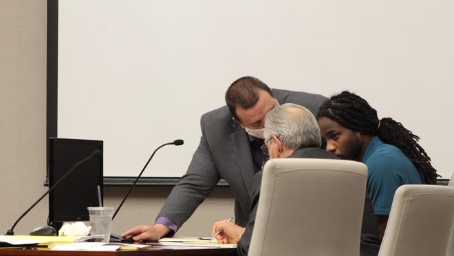 Brandon Ivy, right, listens to attorney Christopher Soon during the first day of his aggravated murder trial in the death of Stephane Hunter. On Wednesday, Ivy decided to represent himself in the expected four-day trial and Soon was excused.