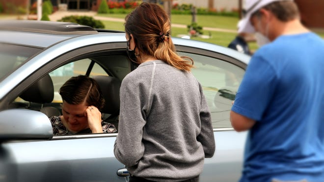 Volunteers from Swansea's His Providence Church help out with a PrayerStop, a drive-thru prayer offering.