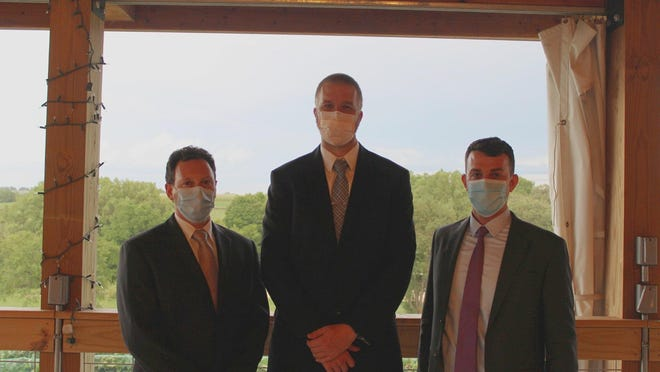 Monroe Clinic honored its four 2020 residency and fellowship graduates at a reception Aug. 28. Pictured, from left: Drs. Michael Donnelly and Jonathan Demory pose at graduation with clinic emergency medicine physician Dr. Ameen Taleb.