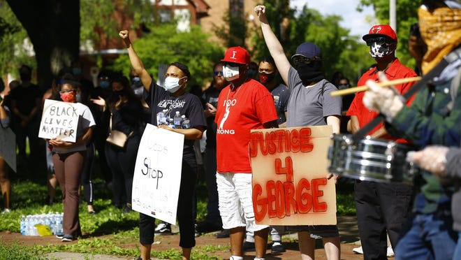 People protesting the death of George Floyd and other African Americans killed by police gather at Haskell Park on Saturday, May 30, 2020, in Rockford.