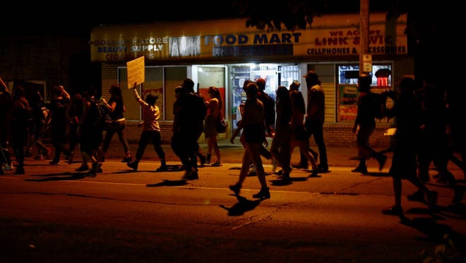 A couple dozen people marched from 10th Avenue Park down Kishwaukee Street on Monday in solidarity with Kenosha, Wisconsin, which erupted in protests and riots after a Black man was shot and wounded by a police officer.