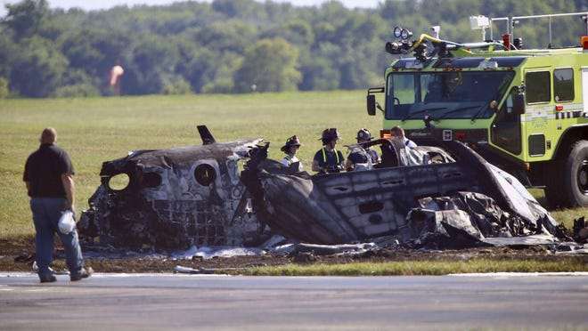 Firefighters and other emergency workers respond Thursday after a plane left the runway at Chicago Rockford International Airport and caught fire.