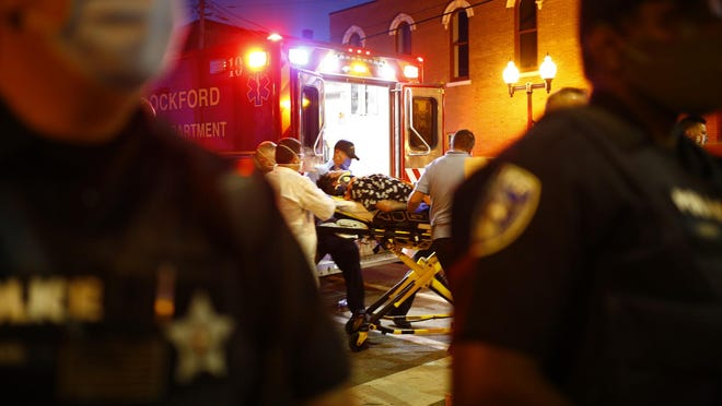 A man is loaded into an ambulance Friday, Sept. 25, 2020, during protests in downtown Rockford. It's unclear what his injuries are but he was taken to the ground by police officers and handcuffed shortly before medical personnel were called.