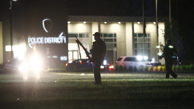 Rockford law enforcement attempts to clear the area outside Rockford Police District 1 headquarters on Saturday, May 30, 2020, in Rockford.