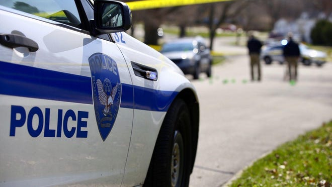 Rockford police investigate a fatal shooting April 2 in the 2100 block of Oregon Avenue. The shooting was one of a record-breaking 36 homicides in Rockford in 2020.