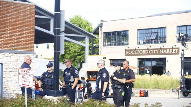 Several Rockford police officers patrol City Market on Friday, Aug. 7, 2020, a week after protesters stopped traffic on East State Street leading to 11 arrests.