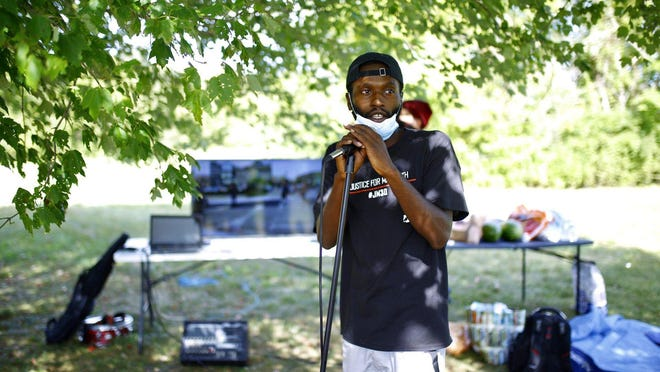 Leslie Rolfe, spokesman for May 30th Alliance, narrates videos of arrests during demonstrations over the summer during a teach-in-style event at Saturn Park on Saturday, Aug. 29, 2020, in Rockford. About 40 people attended.