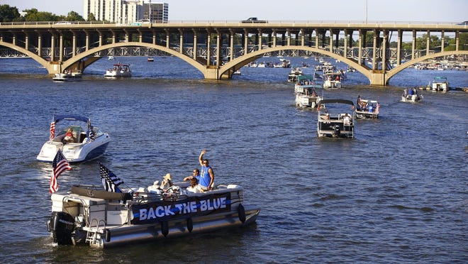 More than 50 boats traveled down the Rock River for a Boat for the Blue rally on Friday, Aug. 21, 2020, in downtown Rockford.