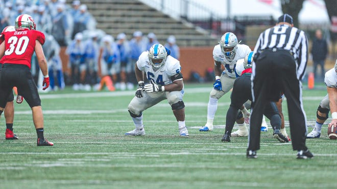 Robert Jones (64), the East High School product who went on to play at Highland Community College in Kansas, is now a standout offensive lineman for Middle Tennessee State University. Jones is drawing the attention of NFL scouts.
