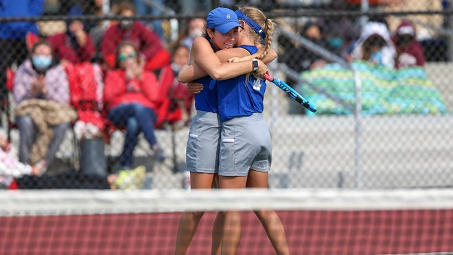 Emma (left) and Sarah (right) Sinclair celebrate winning the Class 5A doubles State Championship at the Andover Tennis Complex in Andover, Kansas. They beat Bishop Carroll 6-2, 7-5 for their first state championship.