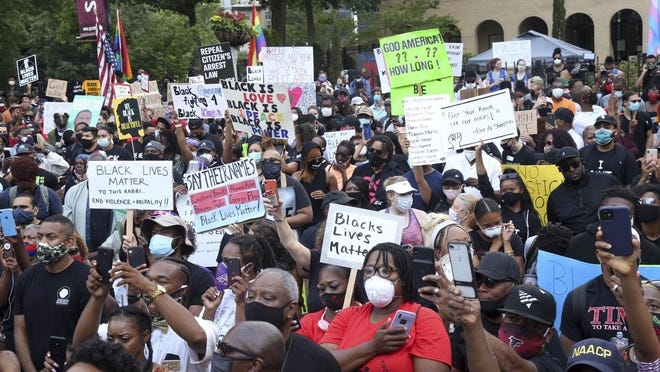 A crowd of demonstrators march to the Capitol Monday, June 15, 2020 in Atlanta. The NAACP March to the Capitol coincided with the restart of the Georgia 2020 General Assembly. Lawmakers returned wearing masks and followed new rules to restart the session during the pandemic.