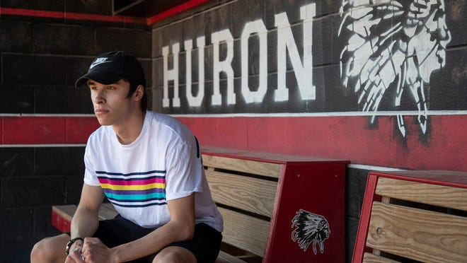 Dylan Offman, a Huron High School alumnus, poses for a photo in the softball home dugout at Huron High School in New Boston, Friday, June 19, 2020.