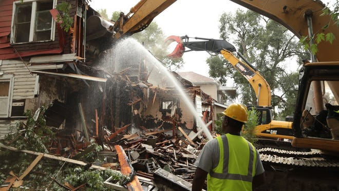 Michigan stands to benefit from the shift in funds more than any other state. Here, demolition crews tear down an abandoned house in Detroit.