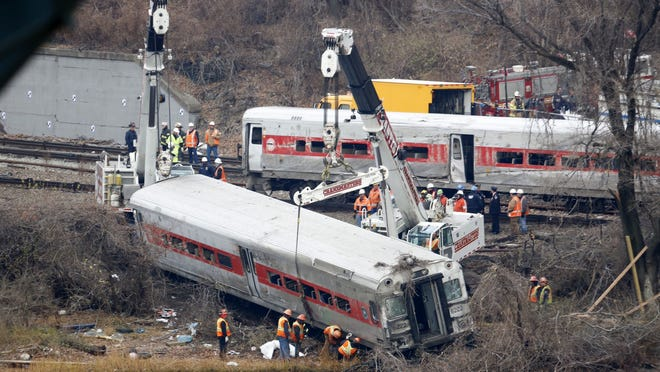 The last car is lifted as a rail crew works Dec. 2 at the scene of the fatal Metro-North train derailment near the Spuyten Duyvil station in the Bronx. The passenger train derailed Dec. 1 en route to New York City, killing four people and wounding dozens more.