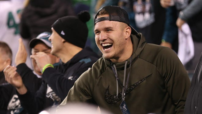 Angels outfielder Mike Trout celebrates from the stands during the Eagles victory over the Vikings in the NFC Championship.