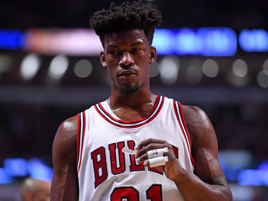 Chicago Bulls forward Jimmy Butler (21) reacts during