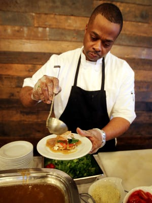 Chef Lorenzo Spratling of Touch of Class Catering in Oak Park  prepares his dish, a Gateau potato pancake with baby spinach leaves, tomatoes, roast turkey and a spinach sage jus, during the Detroit Free Press Feast Thanksgiving tasting event at the Great Lakes Culinary Center in Southfield.