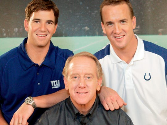 In this May 8, 2008, file photo, Archie Manning, center, is joined by his sons Eli Manning, left, and Peyton Manning, in Beverly Hills, Calif.