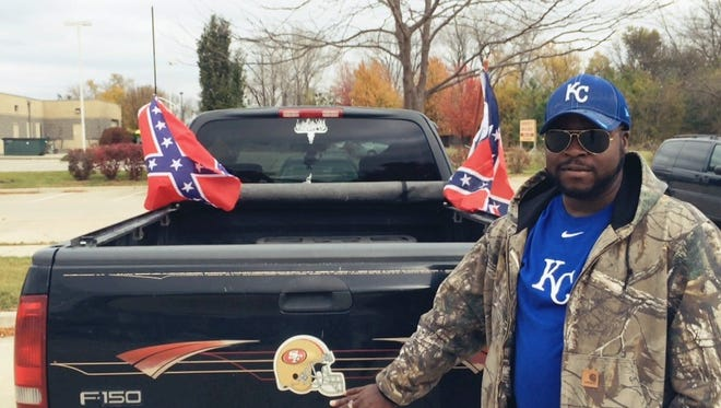 Ben Carson supporter B.C. Johnson of St. Paul, Minn., flies two Confederate flags on the back of his pickup truck as a symbol of states' rights and freedom from the federal government.