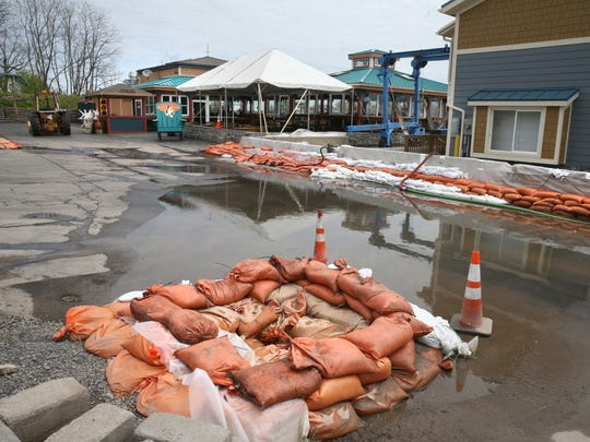 Sandbags surround a break wall along side the Pelican's Nest Restaurant, at 566 N. River St. in Rochester, as the rising waters from Lake Ontario flood into the mouth of the Genesee River and flood out the popular restaurant on Friday, May 12, 2017.