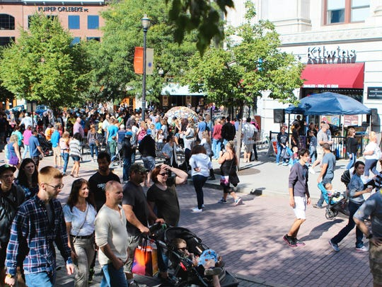 Thousands of people packed the downtown streets in Grand Rapids on the first Saturday of ArtPrize Eight on Saturday, Sept. 24, 2016