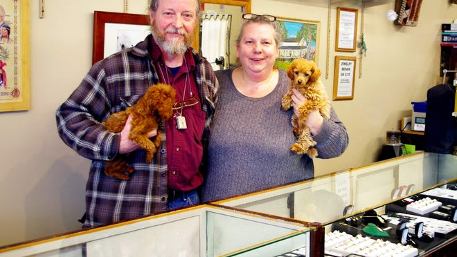Dennis and Kim Morris with their dogs, Spirit and Thunder.