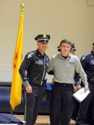 Ricky Villalobos Jr., right attended the New Mexico State Police Youth Academy, which was designed to show youngsters about law enforcement with the State Police. At left, is Officer Anthony Luna of the Training and Recruiting Division.