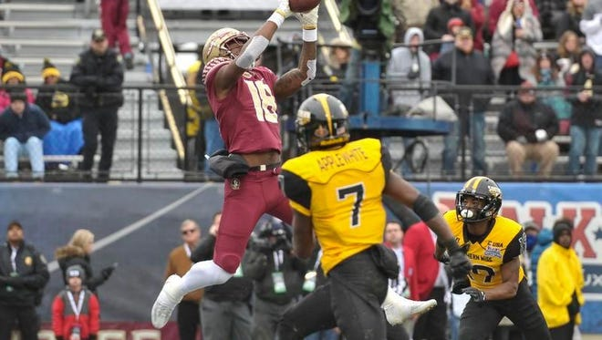 Florida State Seminoles wide receiver Auden Tate (18) catches a touchdown pass against Southern Miss Golden Eagles defensive back Jomez Applewhite (7) during the first half in the 2017 Independence Bowl at Independence Stadium.