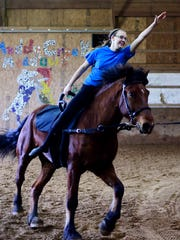 Susan Kelly, 17, of Airville, rides Hugo as she practices with the Muddy Creek Vaulters in Lower Chanceford Township Tuesday, March 7, 2017. Elements of dance and gymnastics are performed on top of a moving horse during equestrian vaulting.