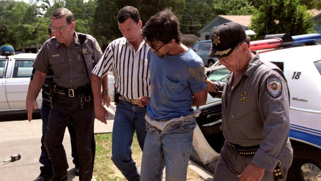 A motion filed by the defense team for convicted killer Darrell Robinson, shown in this Town Talk file photo after his capture in Evangeline Parish in 1996, before Tuesday's hearing seeks thousands of pages of documents they allege were not turned over, as well as deposition dates for the original prosecutor and other law enforcement officers.