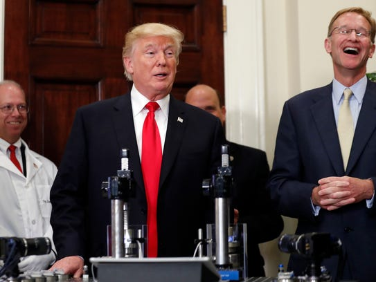 President Donald Trump speaks, with Wendell P. Weeks,